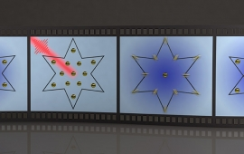 A film reel of 4 frames shows an artist's depiction of atoms in a start shape being blasted by a laser and then responding